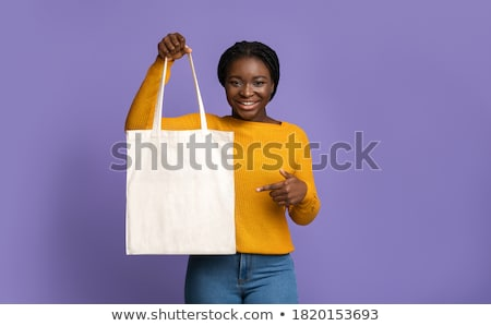 Woman looking at recycling logo Stock photo © IS2