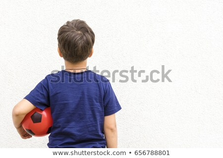Young boy heading a football. Stock photo © IS2
