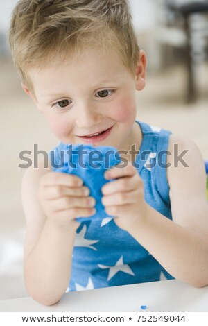 young boy playing with molding rubber Stock photo © IS2