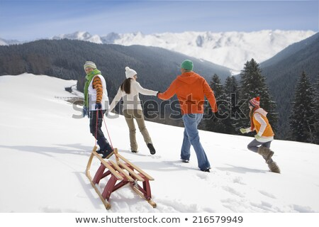 Woman walking up hill in snow, with skis Stock photo © IS2