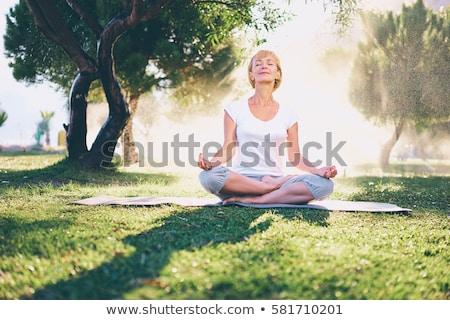 kıdemli · kadın · yoga · deniz · uygunluk - stok fotoğraf © boggy