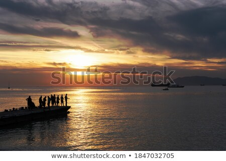 Fishing on Sunset Back with Fisherman Character Stock photo © robuart
