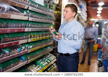 Stock photo: Portrait Of Electrician Repairing Hardware Part