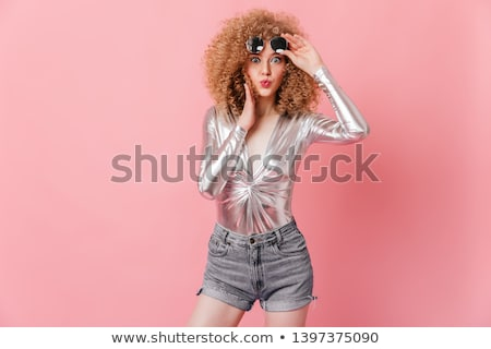 Smiling blonde curly woman in dress take off sunglasses Stock photo © deandrobot