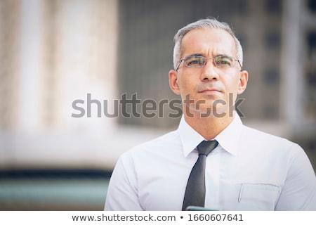 Hideg üzletember irodaház komoly fiatal üzletember Stock fotó © lichtmeister