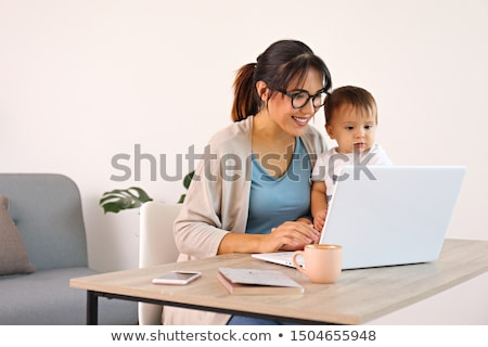 Mother on laptop computer Stock photo © gemphoto