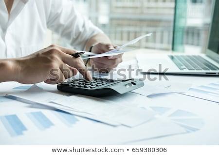 Jovem empresário projeto de lei escritório computador laptop Foto stock © AndreyPopov