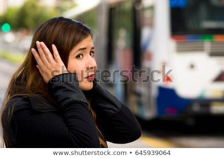 asian woman closing ears by hands on city street Stock photo © dolgachov