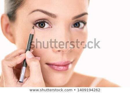 Makeup beauty Asian woman applying brown pencil eyeliner on eye. Face eyes care lifestyle isolated o Stock photo © Maridav