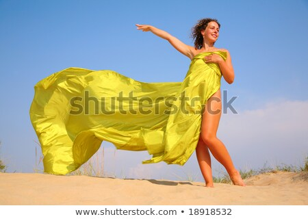Young girl on sand with yellow shawl in hands Stock photo © Paha_L