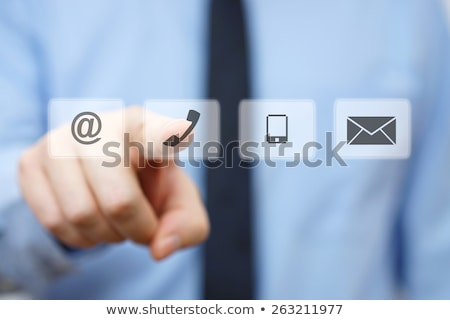 Foto stock: Press Contact Us Button On Telephone
