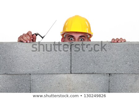 Mason behind a wall Stock photo © photography33