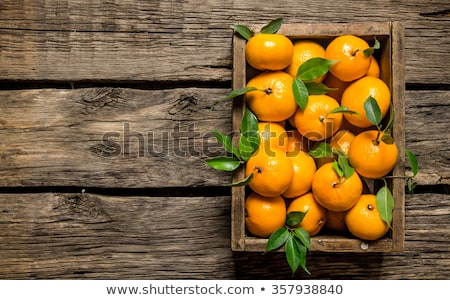 old wooden box with mandarines Stock photo © compuinfoto