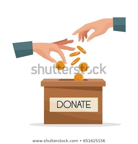 Hand donating money to charity Stock photo © wavebreak_media