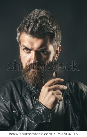 Handsome carpenter holding electric saw Stock photo © photography33