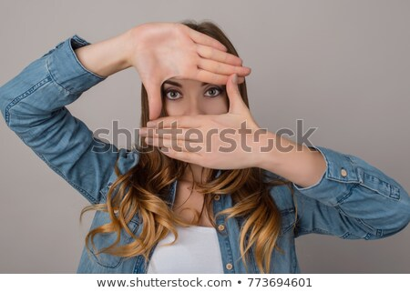 woman holding her fingers up in a square shape stock photo © pablocalvog