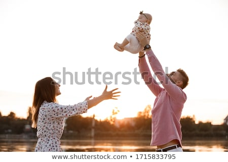 Man lifting his daughter in the air Stock photo © photography33