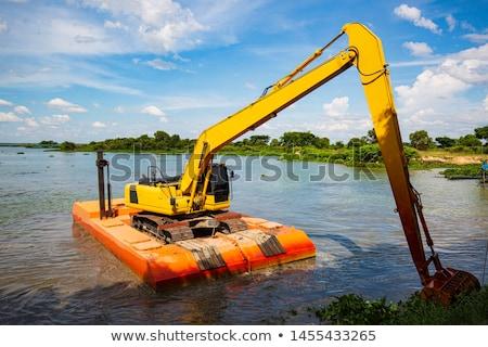 Foto stock: Escavadeira · trabalhando · máquina · terra · em · movimento · trabalhar