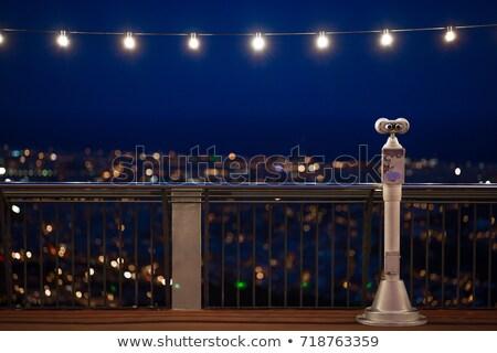 Lámpa erkély sziluett épület város fény Stock fotó © zzve