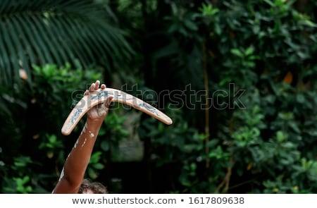 Férfi kéz tart bumeráng közelkép fehér Stock fotó © AndreyPopov