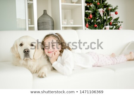 Girl cuddling a tree Stock photo © Kzenon