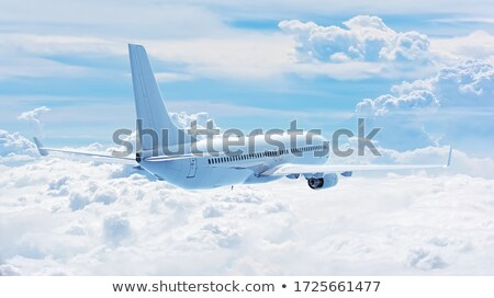 Airliner and clouds Stock photo © c-foto