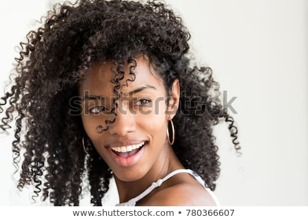 Young beautiful woman with long curly hairs indoors Stock photo © amok