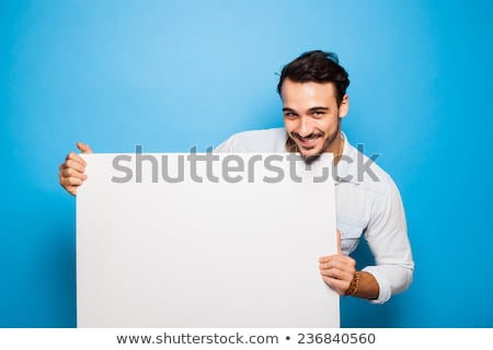 handsome man holding blank panel stock photo © wavebreak_media