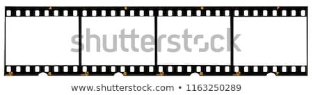 Blank white in black film frame Stock photo © badmanproduction