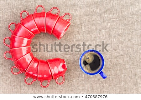 Eleven mugs stacked in the shape of the letter C Stock photo © ozgur