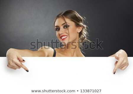 A girl pointing at the empty signboard Stock photo © bluering