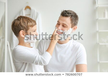 Man in bathroom shaves Stock photo © jossdiim