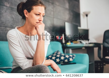 Beautiful sad woman stock photo © konradbak