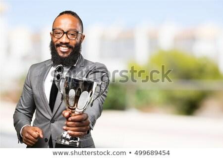 Młodych człowiek trofeum złoty Zdjęcia stock © RAStudio