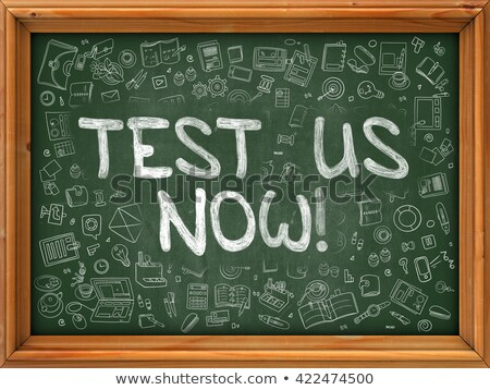 Test Us Now - Doodle Illustration on Green Chalkboard. Stock photo © tashatuvango
