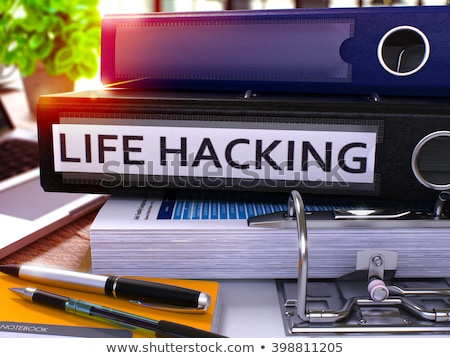 Black Office Folder with Inscription Life Hacking. Stock photo © tashatuvango