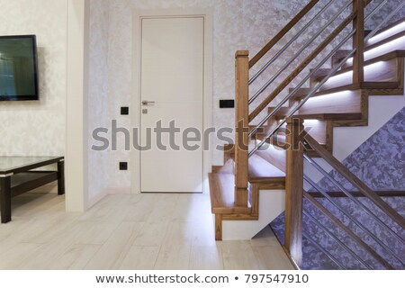 Interior wooden stairs with metal railing Stock photo © wavebreak_media