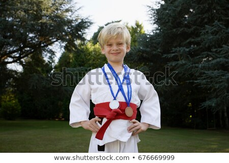 Boy in Karate Kit,  with medals Stock photo © IS2