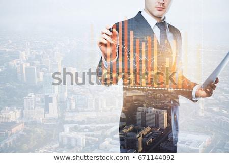 European businessman with business diagram Stock photo © studioworkstock