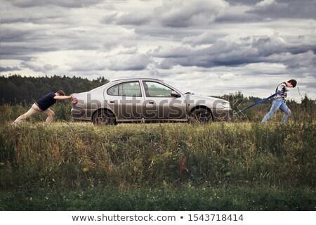 Couple pushing broken down car Stock photo © IS2