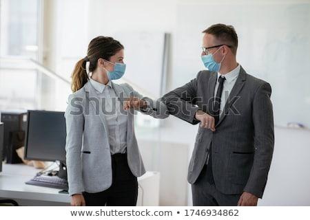 бизнесмен · приветствие · бизнеса · заседание · костюм · студию - Сток-фото © monkey_business