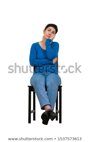 Young businesswoman sitting on a chair isolated on white Stock photo © Minervastock