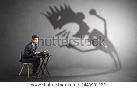 man working and he is afraid of a yelling shadow stock fotó © ra2studio