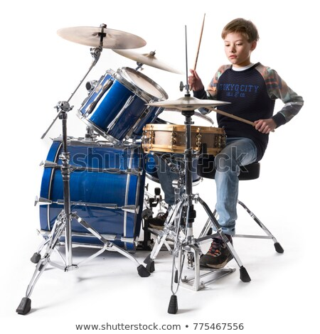 boy playing drum with music notes in background stock photo © colematt