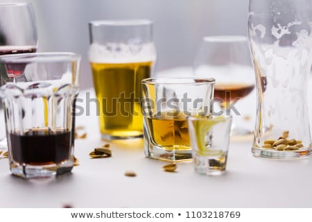 Szemüveg különböző alkohol italok rendetlen asztal Stock fotó © dolgachov