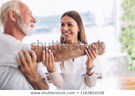 Doctor old men_exercise Stock photo © toyotoyo