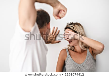 man beating helpless woman at home white background stock photo © lopolo