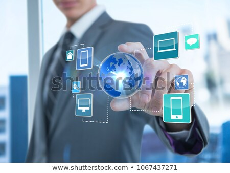 businessman with hand spread of taking earth with application icons business blurred background stock photo © wavebreak_media