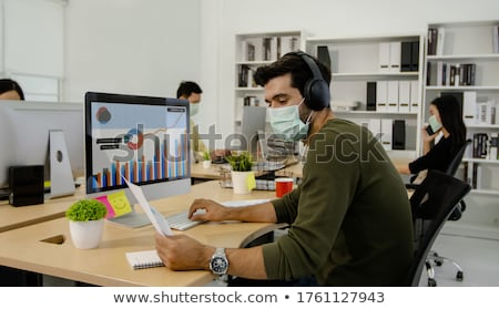 businessman analyzing the business graph at work place stock photo © andreypopov
