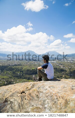 hispanic latin man in a top of a in mountain hiking stock photo © pedromonteiro